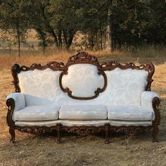 Vintage Cream Couch with Ornate Wood Trim