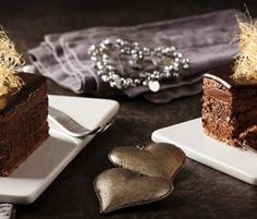 Chocolate Pistachio Layer Cake: This dark chocolate layer cake is studded with crunchy praline and green pistachios for added deliciousness. http://www.bakers-corner.com.au/recipes/cakes/chocolate/chocolate-pistachio-layer-cake/