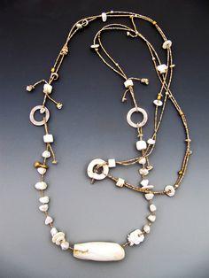 Lucia Antonelli - Antique Naga shell bead, fresh water pearls,antique ostrich egg shell heishi, antique Orissa bronze, silver, antique New Guinea shell ring