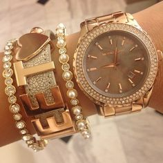 I WANT THIS SO BAD!! The BCBG bracelet with the Michael Kors watch. Very nice and a statement. Love it.