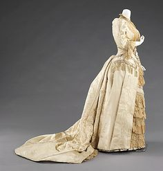 Court Presentation Dress by the House of Worth ca. 1885. This grand dress was worn for a presentation to Princess Alexandra of Denmark (1844-1925) at the court of Queen Victoria (1819-1901). Being presented to royalty was an aspiration for many Americans at the time and justifies the purchase of such an elaborate gown for such a situation.