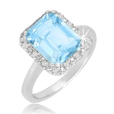 5 Carat Emerald Cut Blue Topaz and 1/10 Carat Diamond Ring in Sterling Silver