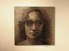 Illusion: Using gun bullets and a quick-fire hand torch, David Palmer has created these unique portraits of John Lennon, Abraham Lincoln, and Tupac Shakur.     (Photos © David S. Palmer) http://illusion.scene360.com/art/25445/facing-the-bullets/