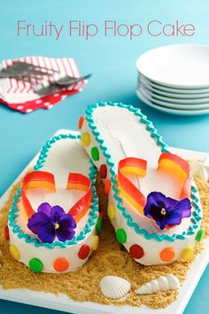 This fashionable and fun cake will make the little ones feel like they're relaxing right on the beach! Fruit by the Foot and chewy fruit candies add bright pops of color; if your supermarket sells edible flowers, pick some up for an extra-special touch. Click through to get the downloadable template and a step-by-step video. Summer Birthday, Birthday Cake Girls, 13th Birthday Cakes, 12th Birthday, Cute Cakes, Pretty Cakes, Fancy Cakes, Flip Flop Cakes, Flip Flops