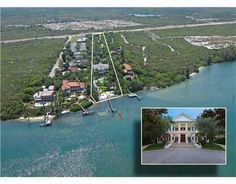 On 100 feet of turquoise, Intracoastal waters this plantation-style estate on 3.3 acres has 4 structures; the Residence, the Carriage House, the Guest Cottage, & Poolside Cabana. Also a Pool, Tiki Hut, sandy beach, fully equipt dock. The stone gate opens to an 1,100 ft winding drive past the NEW 4-bedroom Cottage on the right, & the Carriage House on the left with living quarters above. 16821 Se Federal Hwy RX-3345981 Intracoastal Waterfront   Tequesta Real Estate