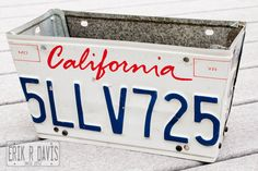 Recycle your past license plates: License Plate Flower Box