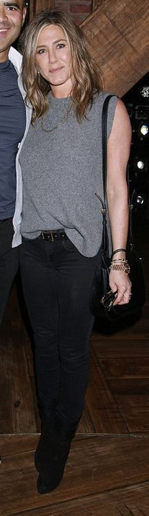 Who made  Jennifer Aniston's gold watch, black handbag, and suede boots?