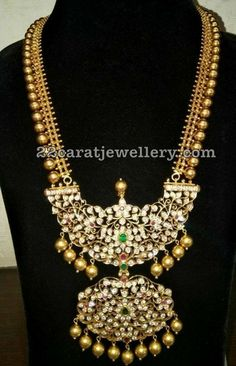 Burmese Rubies adorned broad mango necklace in kundan work and 22 carat gold with peacock pendant