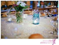 jars with flowers... centerpeice inspiration