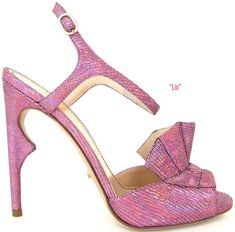 Jerome C.Rousseau 'Lio' ankle-strap sandal with a 3-d fan bow in lizard-embossed pink glitter fabric and thorn-shaped heel
