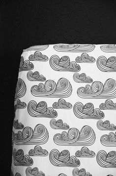 Swirly Clouds crib sheet by Candy Kirby Designs.