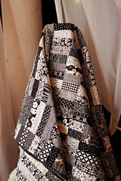 I have always loved black and white quilts ...