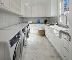 Laundry room with four machines- I am really hoping to have a laundry room with two sets of appliances like this one soon! This would make my life much easier! Laundry room with four machines- Laundry room with four machines- Laundry room with four machines #Laundryroom #laundryroomfourmachines Brandon Architects, Inc