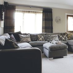 A sungold and grey living room with at least 10 different patterns