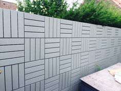 IKEA RUNNEN floor decking tiles work great as a wall fence