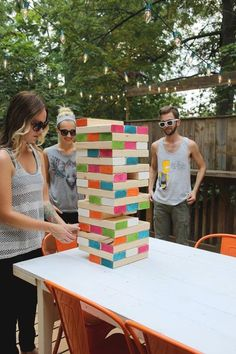 Most outdoor games require you to have a lot of space — bocce ball, horseshoes, cornhole, croquet. But how fun does this look?! This well-loved game can set up easily on a small patio, and all you need is a level surface to stack the blocks. Learn how to make your own!