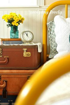 Suitcase. Clock. Mustard yellow. Bed frame. Painted paneling. Teal. love. love. love.