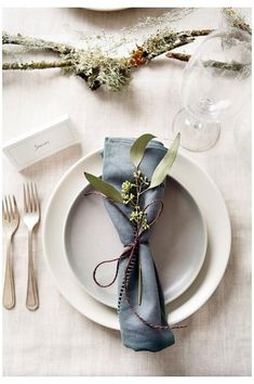 Gardens: how to display winter foliage Gardens: how to display winter foliage Place setting with blue napkin and foliage<br> December is a time to bring bunches from the garden indoors – and keep them looking fresh for longer Dinner Napkins, Dinner Table, Wedding Table Place Settings, Blue Table Settings, Diy Place Settings, Table Wedding, Dinner Places, Wedding Napkins, Wedding Napkin Folding