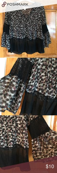 Forever 21 Blouse Forever 21 Blouse. Sheer with a sheer black on the bottom trim and the sleeve!  A floral print shirt. Size medium. Worn once! Perfect condition! Pairs well with jeans and booties. Forever 21 Tops Blouses