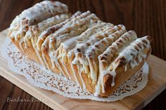 Layers of light, fluffy sweet bread sandwiched with sweet, fragrant lemon sugar, then drizzled with a tart lemon glaze.