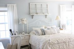 such a pretty bedroom, ooh have the headboard like it. love the blue too but wonder if it would be too much blue in my house. hmm