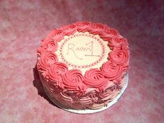 Pretty little pink ombre rosette cake for a baby's first birthday. All done in cream cheese frosting as the cake is a vegan carrot, so the whole cake is egg-free. Of course everything in our bakery is also nut-free.   Spiritual Ingredients Bakery White Rock, BC