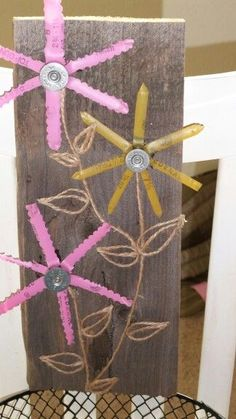 Shotgun shell flowers on barnwood