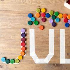 Invitation to play & learn. Letters leren herkennen van de eigen naam. Alleen had madam er geen zin in :) dus het werd stapeltjes omgooien en door de kamer heen schoppen 😅😂. Ach... als ze daar plezier aan beleeft is het ook goed. #grapat #lettersherkennen #naampuzzel #invitationtoplay #celebratelife @joguines_grapat Triangle, Games, Gaming, Plays, Game, Toys