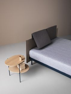 Pliè bed by Caccaro, fabric double bed with adjustable headrest design Tommaso Calore