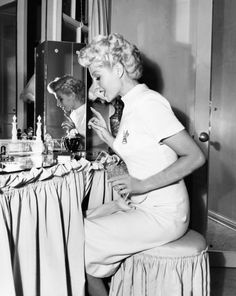 Rita Hayworth at her dressing table (love her hair here!). #vintage #1940s #actresses #beauty #vanity_table