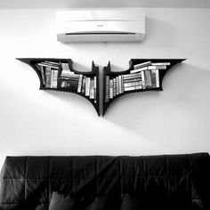 """FTA: """"Fahmi Sami's bookshelves are perfect for your own Batcave library. They're modeled on the logo from The Dark Knight trilogy."""" Perfect for all those computer manuals that Bruce Wayne needs. (via Neatorama)"""