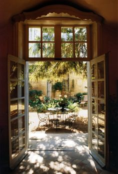 French doors and transom to interior courtyard