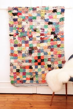 "Made with recycled fabrics, this rag rug (also known as ""boucherouite"" rug) is a soft and shaggy conversation piece for your home."