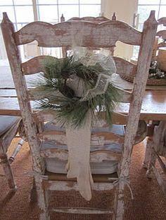 Love the chair with the small wreath.