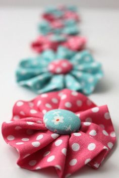 """Like a yo yo pattern. Dont throw old shirts/blouses away because they have a """"no hope stain"""". Cut them up for bows like this."""