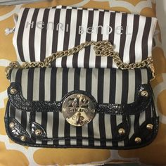 Henri Bendel clutch *brown stripe* Brown stripe Henri Bendel clutch perfect for a night out or just a quick run to the supermarket. Cute and very versatile. Goes well with everything. Love pairing this clutch with white tees and jeans. Bought this myself at Henri Bendel store in Orlando. Condition is 7/1O I would say and comes with dustbag. henri bendel Bags Clutches & Wristlets