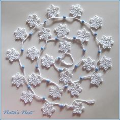 Snowflakes Garland - http://www.favecrafts.com/Crochet/Snowy-Garland-Crochet-Pattern-from-Red-Heart-Yarn