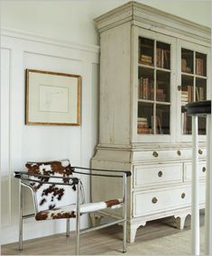 swedish and mid-century trim moulding, cowhide chair, white armoire Residential Interior Design, Best Interior Design, Glass Cabinet Doors, China Cabinet, Glass Doors, Book Cabinet, Home Remodeling Diy, Transitional Living Rooms, Traditional Interior