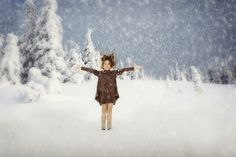 www.frostedproductions.com | #utah #photographer #editorial #photographer #studio #photography #winter #cute #little #girl #playing #in #the #snow #pine #trees #blue #sky