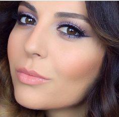 Purple eye makeup and pink lipstick