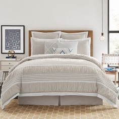 The ultimate in cozy bedding: A seersucker motif in warm beige and white tones.
