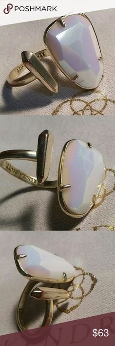 WHITE IRIDESCENT AUSSIE GOLD RING S/M KENDRA SCOTT AUSSIE RING  WHITE IRIDESCENT STONE  SIZE SMALL / MEDIUM ADJUSTABLE   STONE HAS SOME WEAR ON IT SEE UP CLOSE FOURTH PHOTO  SOME GOLD PLATING COMING OFF THE BACK  USED CONDITION  CUSTOM  NO DUST BAG INCLUDED    PRICE IS FIRM NO OFFERS PLEASE Kendra Scott Jewelry Rings
