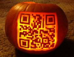 Halloween pumpkin carved with a QR Code