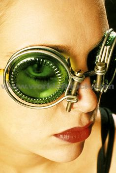 Stock Photo titled: Close-up Portrait Of A Woman Wearing  Green-tinted Fashion Googles.