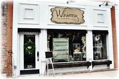 Love this store front..so shabby chic...vintage.
