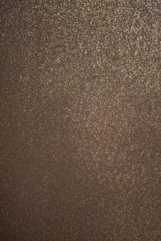 Glitter wall paint from Benjamin Moore plus extra microglitter on top of dark gray