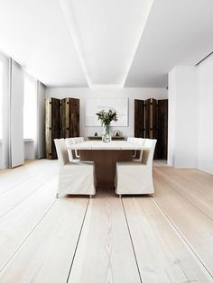 like slip-covered chairs and use of screens to give architectural detail.  Also ceiling treatment.