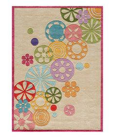 The soft, sweet details of this rug add just the right touch of classic charm to perfectly accent any nursery or child's room. The simple yet modern background of this handcrafted rug makes it a wonderful transitional piece that can grow with them through the years.