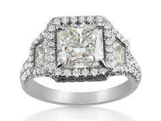 J.B. Star Engagement Ring, Fashioned in Platinum, Featuring a 1.80 Carat Radiant Diamond, F Color, SI1 Clarity, GIA Certfied, Accented with 2 Trapezoid Diamonds =.43cts Total Weight and 134 Round Diamonds =.62cts Total Weight