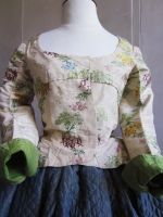 1780-90, France. Exceptional Perriot Jacket of damask silk. Earlier textile probally resewn into the later style garment. Linen lining corseted front with eyelets for lacing (instead of the rigid bodice!). Pekin silk re-used for the V back and light green chiffon silk for the lining of the sleeves. Measures: Shoulder 33cm, Sleeve 51cm, waist 60 cm, chest 78 cm, height 27 cm bust. | Villa Rosemaine